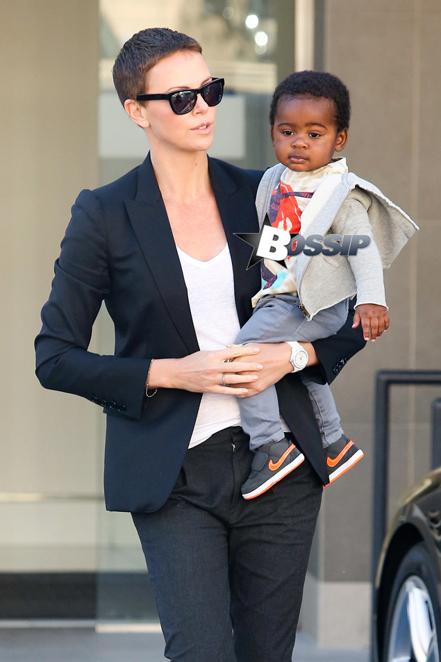 Charlize Theron holds onto her adorable baby boy Jackson as they leave a medical building in Beverly Hills this morning. The 37-year-old actress, her mother Gerda and Jackson made their way through the parking lot after the doctor's appointment.