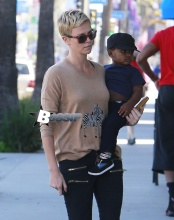Charlize Theron stops for a sweet snack at Pinkberry with her son Jackson in West Hollywood, California on March 11, 2013