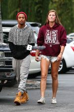 Lil Romeo and a date arrive at the Calabasas Commons for a fun night at the movies. Romeo's companion wore a pair of cut-off jeans shorts and a maroon 'Billion Dollar Dream Club' hooded sweatshirt. The 23-year-old son of Master P has made a successful career in acting, rapping, modeling. He appears well on his way into the club!
