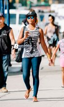 Rapper-songwriter Eve seen wearing a zebra print tank top and Philadelphia Phillies baseball cap, while shopping in the SoHo neighborhood of NYC.
