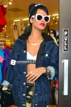 Pop star Rihanna is all smiles as she leaves American Apparel store in the West Village, New York, after some retail therapy.