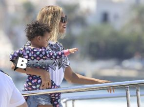 Singer Beyonce carries her daughter Blue Ivy onto a yacht in Ibiza, Spain on September 2,