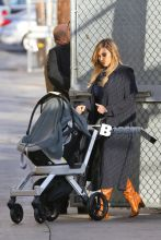 New mom Kim Kardashian and baby North West arrive for the taping of Jimmy Kimmel Live.