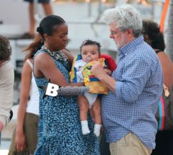Star Wars creator George Lucas showing new baby girl born in august Everest during an escale in Saint Barth with wife Mellody Hobson