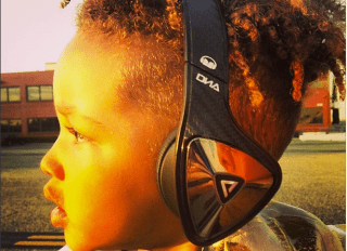 Egypt Dean wears Monster headphones