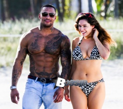 British model Kelly Brook and boyfriend David McIntosh show off their toned beach bodies as they spend the day at the Shore Club in Miami.