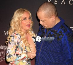 """Ice T and Coco may have been feeling a little """"sheepish"""" as Coco had a small wardrobe malfunction exposing one of her nipples and nearly a full breast, Ice T didn't seem to mind and even had a good laugh. The celebrity couple are attending the """"ESPN THE PARTY"""" pre Super Bowl party at Pier 36 in New York."""