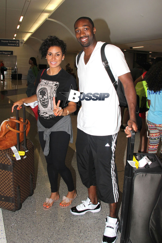 Gilbert Arenas and his significant other Laura Govan pose for pictures as they make their way through the terminal at LAX. The three-time NBA All-Star has done very well for himself after the end of his professional career. Arenas pulled in nearly $25 millions dollars last year while not actually playing in the NBA!