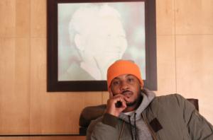 Carmelo Anthony sits at Nelson Mandela's desk
