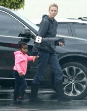 'The Huntsman' actress Charlize Theron takes her son Jackson to a Rite-Aid pharmacy in West Hollywood, California on December 16, 2014. Charlize had Jackson dressed in a bright pink hoodie,