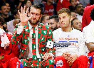 Los Angeles Clippers' Spencer Hawes, left, waves to the crowd wearing a Christmas themed suit next to Blake Griffin during the first half of an NBA basketball game against the Golden State Warriors, Thursday, Dec. 25, 2014, in Los Angeles.