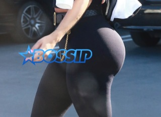 Model Amber Rose hides her face with a black scarf while leaving a nail salon in Studio City, California