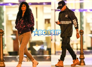 Kylie Jenner liked 'Fifty Shades of Grey' so much the first time, that she took her rumored boyfriend Tyga to see it! The 17-year-old reality star walked out of the theater separate from Tyga, looking quite juvenile in a purple Bape hoodie, grey joggers and a backpack. The 25-year-old rapper stared down at his phone, not looking for any attention.