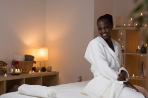 shutter black woman spa robe candles peace