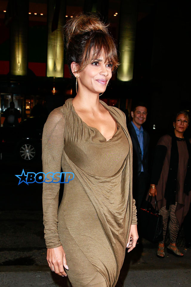 AKM-GSI AKM-GSI Halle Berry at the Revlon finale celebration honoring the top winners of the Revlon Love Is On Million Dollar Challenge at the Rainbow Room in New York City. olive green dress armpit sweat stain