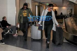 AKM GSI Chadwick Boseman female friend arrive at LAX