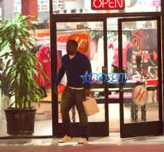 SplashNews Sean Combs &Kim Porter Shop At The Hustler Store