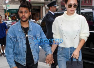 The Weeknd Bella Hadid hold hands leaving Nobu for her birthday AKM-GSI