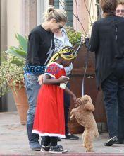 FameFlynetPictures Jillian Michaels Lukensia Rhoades colorful yellow braids santa costume pet dog ollo restaurant