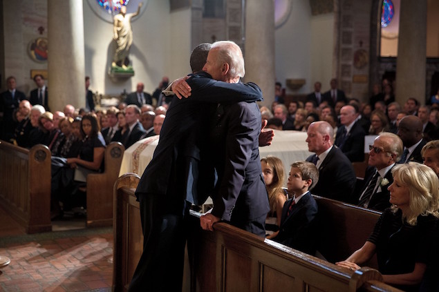 President Barack Obama 16 Biden hug funeral