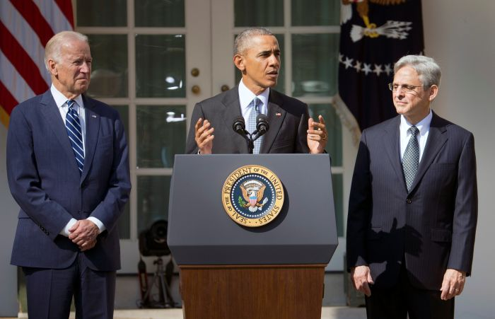 Federal appeals court judge Merrick Garland, right, stands with President Barack Obama and Vice President Joe Biden as he is introduced as Obama's nominee for the Supreme Court during an announcement in the Rose Garden of the White House, in Washington, Wednesday, March 16, 2016. (AP Photo/Pablo Martinez Monsivais)