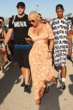FameFlynetPictures Amber Rose Coachella fun bags maxi dress day 3