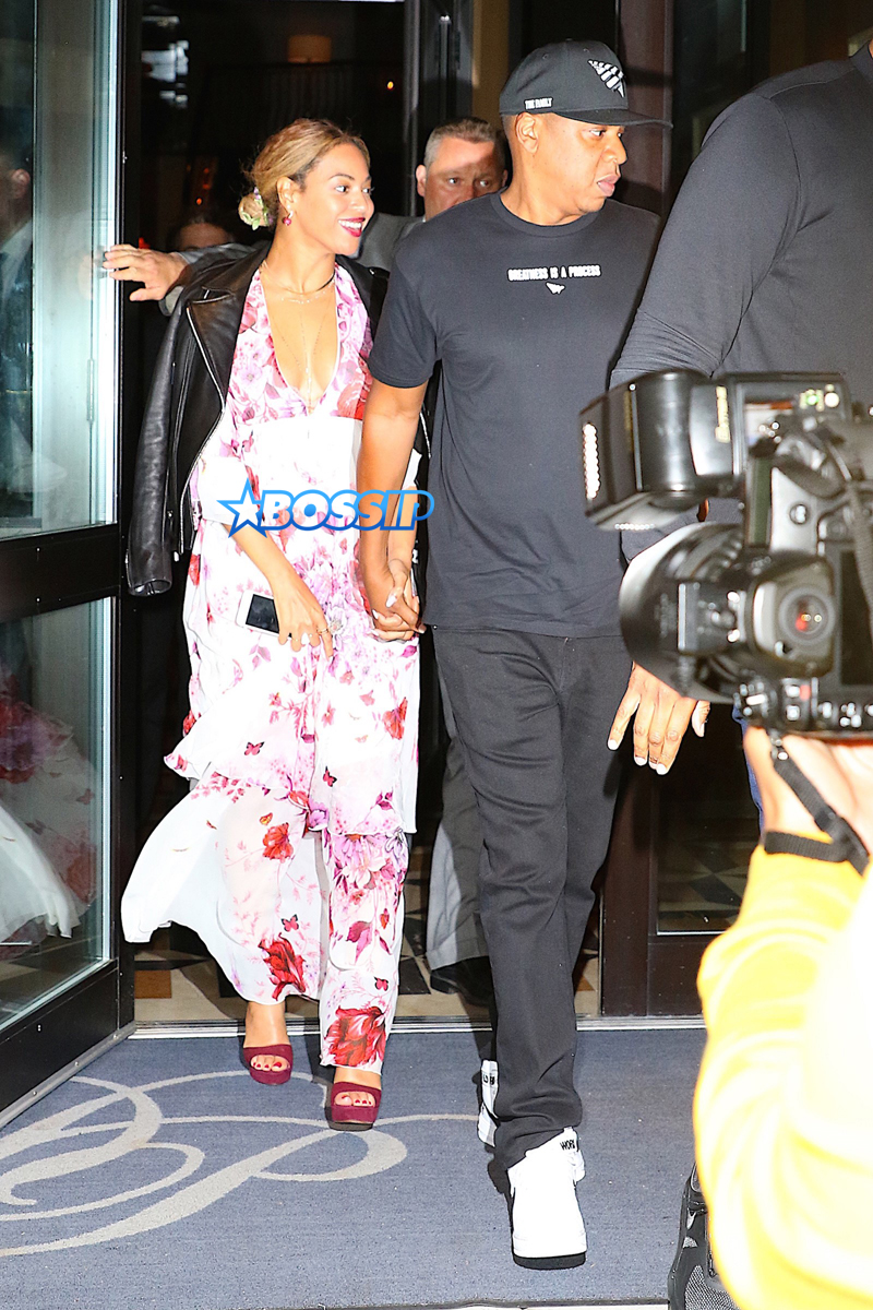 Beyonce and Jay Z are dinner date at Del Posto restaurant in New York City. Beyonce in a black leather jacket over a pink and white floral print dress; while Jay-Z dressed comfortably in a  'Greatness Is A Process' graphic tee, track pants and a black cap.    AKM-GSI