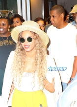 Jay Z and Beyonce leave their midtown office for his niece's graduation party. yellow pants white top white blazer straw hat and yellow handbag. AKM-GSI 27 MAY 2016