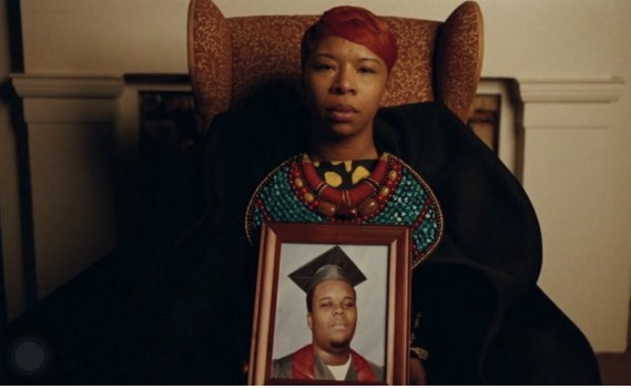 Lezley McSpadden with photo of son Mike Brown in Beyonce Freedom Video