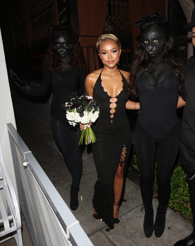 Karrueche Tran arrives at The District with flowers in hand to celebrate her 28th Birthday Party in West Hollywood, CA. Pictured: Karrueche Tran Ref: SPL1282064 140516 Picture by: Photographer Group / Splash News Splash News and Pictures Los Angeles: 310-821-2666 New York: 212-619-2666 London: 870-934-2666 photodesk@splashnews.com