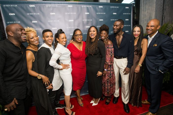 """NEW ORLEANS, LA - JULY 02: (L-R) Omar Dorsey, Tina Lifford, Nicholas Ashe, Dawn-Lyen Gardner, Oprah Winfrey, Ava DuVernay, Rutina Wesley, Kofi Siriboe, Bianca Lawson and Dondre Whitfield attend a cocktail reception for """"Queen Sugar"""" at Liberty Kitchen on July 2, 2016 in New Orleans, Louisiana. (Photo by Josh Brasted/Getty Images for OWN: Oprah Winfrey Network) *** Local Caption *** Omar Dorsey; Tina Lifford; Nicholas Ashe; Dawn-Lyen Gardner; Oprah Winfrey; Ava DuVernay; Rutina Wesley; Kofi Siriboe; Bianca Lawson; Dondre Whitfield"""