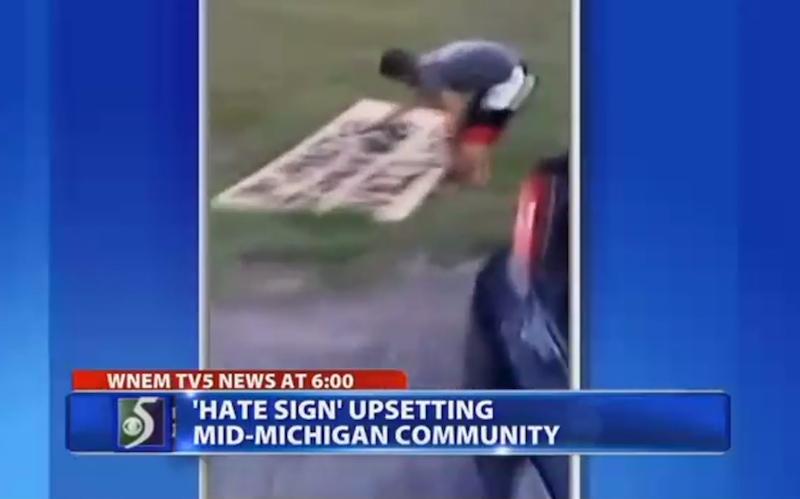 Michigan man destroys racist sign