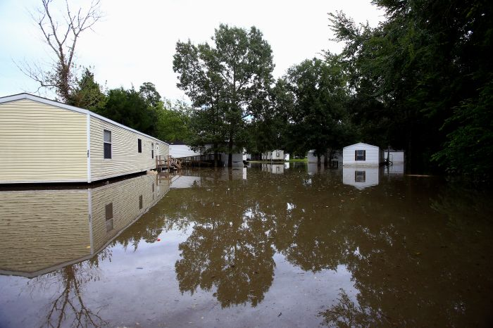 Water remains high near homes after recent rain Tuesday, Aug. 16, 2016, in Abbeville, La. (Gabe Hernandez/Corpus Christi Caller-Times via AP)