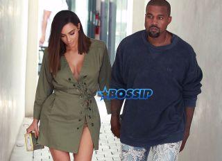 Kanye West Kim Kardashian at Ysabel restaurant in West Hollywood on July 31, 2016. short army green lace up dress Louis Vuitton purse The Petite Metallic. FameFlynet
