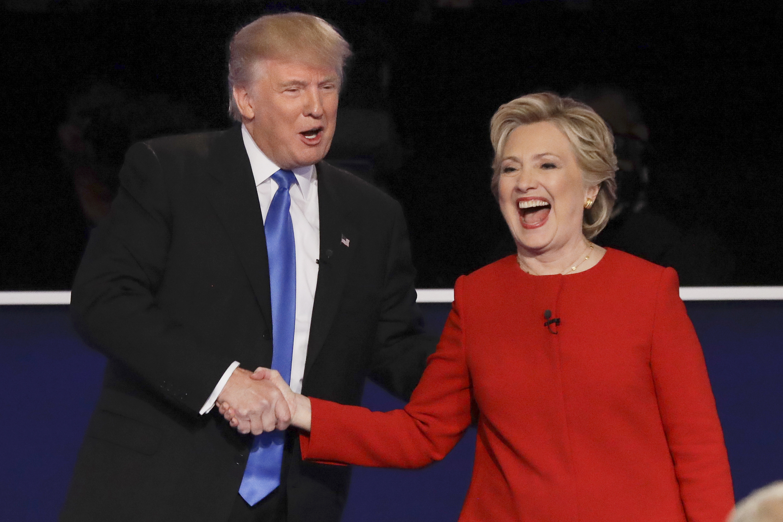 Republican presidential nominee Donald Trump and Democratic presidential nominee Hillary Clinton shake hands after the presidential debate at Hofstra University in Hempstead, N.Y., Monday, Sept. 26, 2016. (AP Photo/David Goldman)