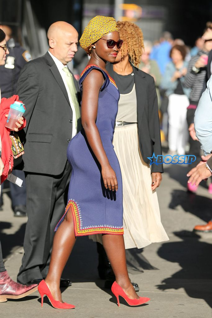 Lupita Nyong'o waves as leaving Good Morning America in New York City, the actress wore a blue dress and red shoes Pictured: Lupita Nyong'o Ref: SPL1362478 260916 Picture by: Felipe Ramales / Splash News Splash News and Pictures Los Angeles:310-821-2666 New York:212-619-2666 London:870-934-2666 photodesk@splashnews.com