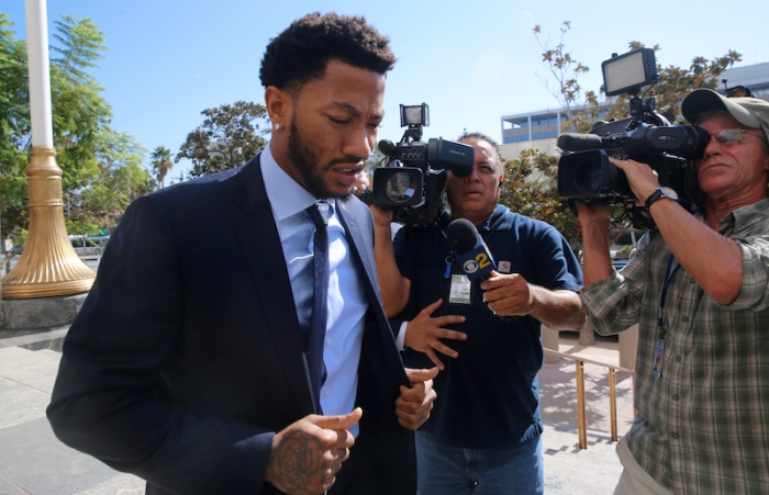 FILE - In this Thursday, Oct. 6, 2016, file photo, New York Knicks basketball player Derrick Rose arrives at U.S. District Court in downtown Los Angeles. The lawsuit alleging NBA star Rose and his friends raped an incapacitated woman is all about consent. Jurors who return to court Tuesday, Oct. 18, for the civil trial will have to determine whether the woman agreed to sex or was too incapacitated to do so. (AP Photo/Damian Dovarganes, File)