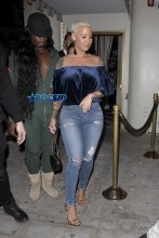 Amber Rose leaves Delilah in West Hollywood. 32-year-old off-shoulder blue velvet top jeans and gold heels. AKM-GSI