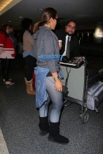 "Evelyn Lozada arrives back in LA via LAX. The ""Basketball Wives"" star is wearing leggings and an Ivy Park hoodie paired with boots. AKM-GSI"