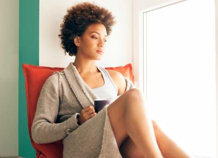 black-woman-sitting-by-window