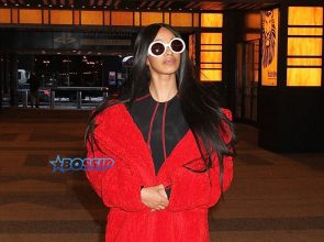 'Love and Hip Hop: New York' star Cardi B MTV Studios VFILES wearing a red fur coat and a black and red bodysuit