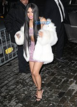 Love and Hip Hop star Cardi B. bares midriff in a pink outfit in New York City. white fur SplashNews