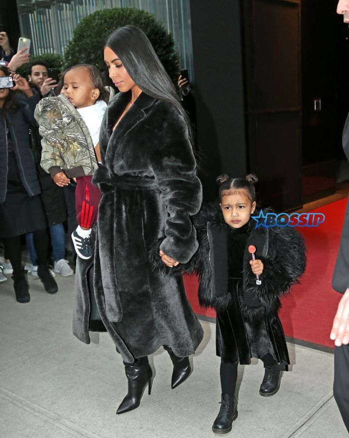 Kim Kardashian steps out with Jonathan Cheban and kids North and Saint West for lunch and North plays with a bull statue outside of the restaurant in New York City. Pictured: kim kardashian, north west, saint west, jonathan cheban Ref: SPL1431837 010217 Picture by: Ryan Turgeon / Splash News Splash News and Pictures Los Angeles:310-821-2666 New York:212-619-2666 London:870-934-2666 photodesk@splashnews.com