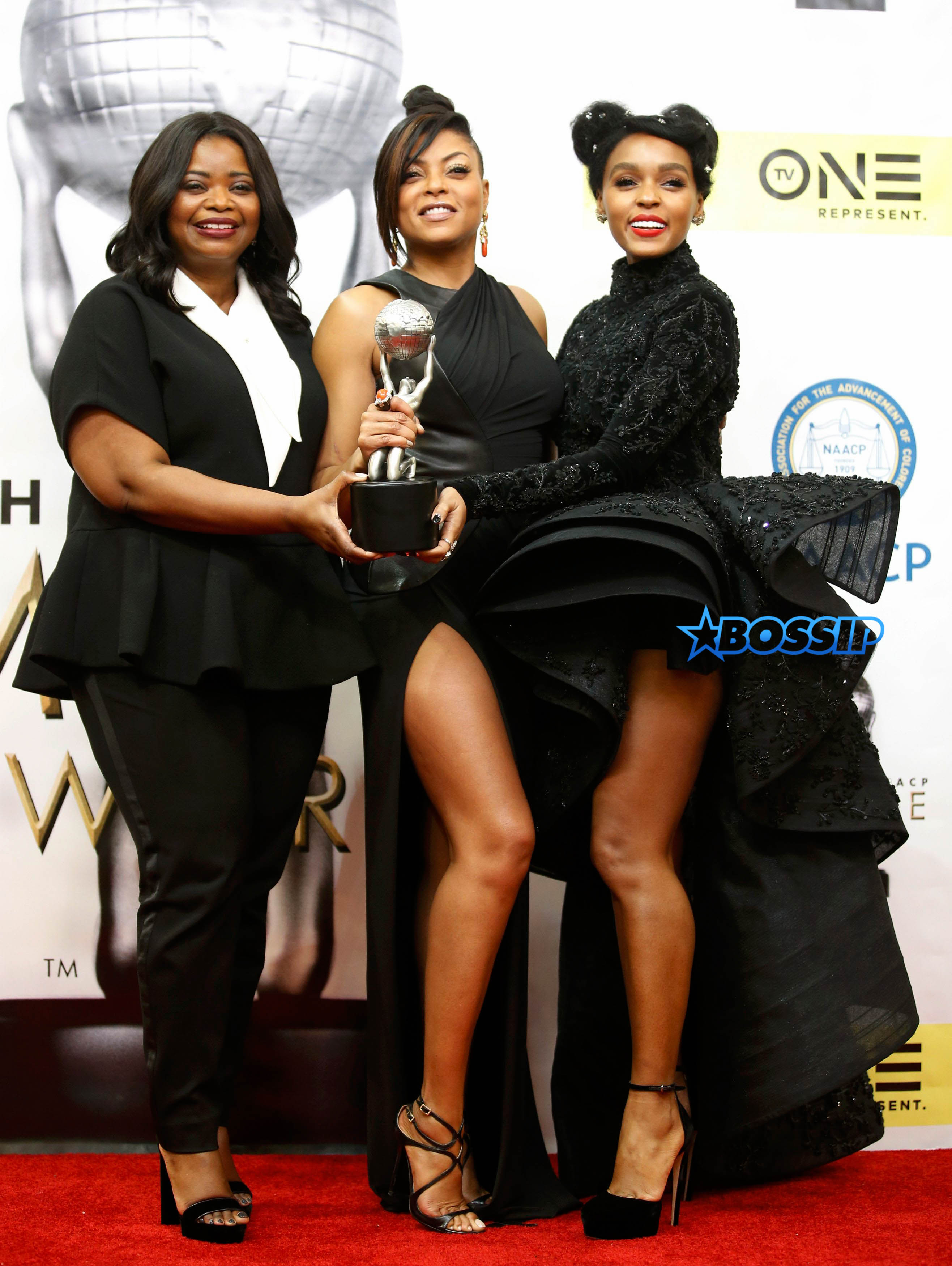 """Celebrities pose with the award for Outstanding Actress in a Motion Picture for """"Hidden Figures"""" backstage at the 48th NAACP Image Awards in Pasadena"""