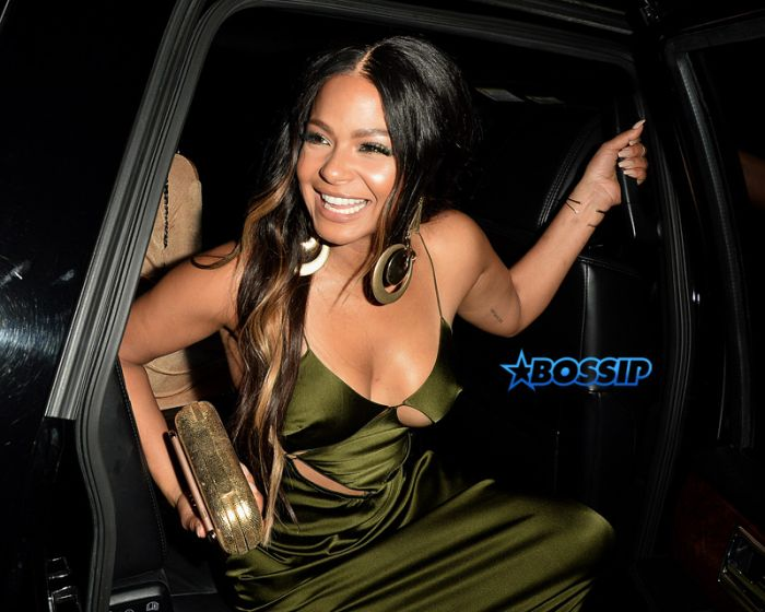 Christina Milian Goes to a Party at The Nice Guy in a Green silk slip dress SplashNews
