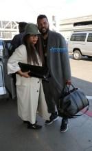 Erykah Badu Carl Jones JFK following Coachella SplashNews