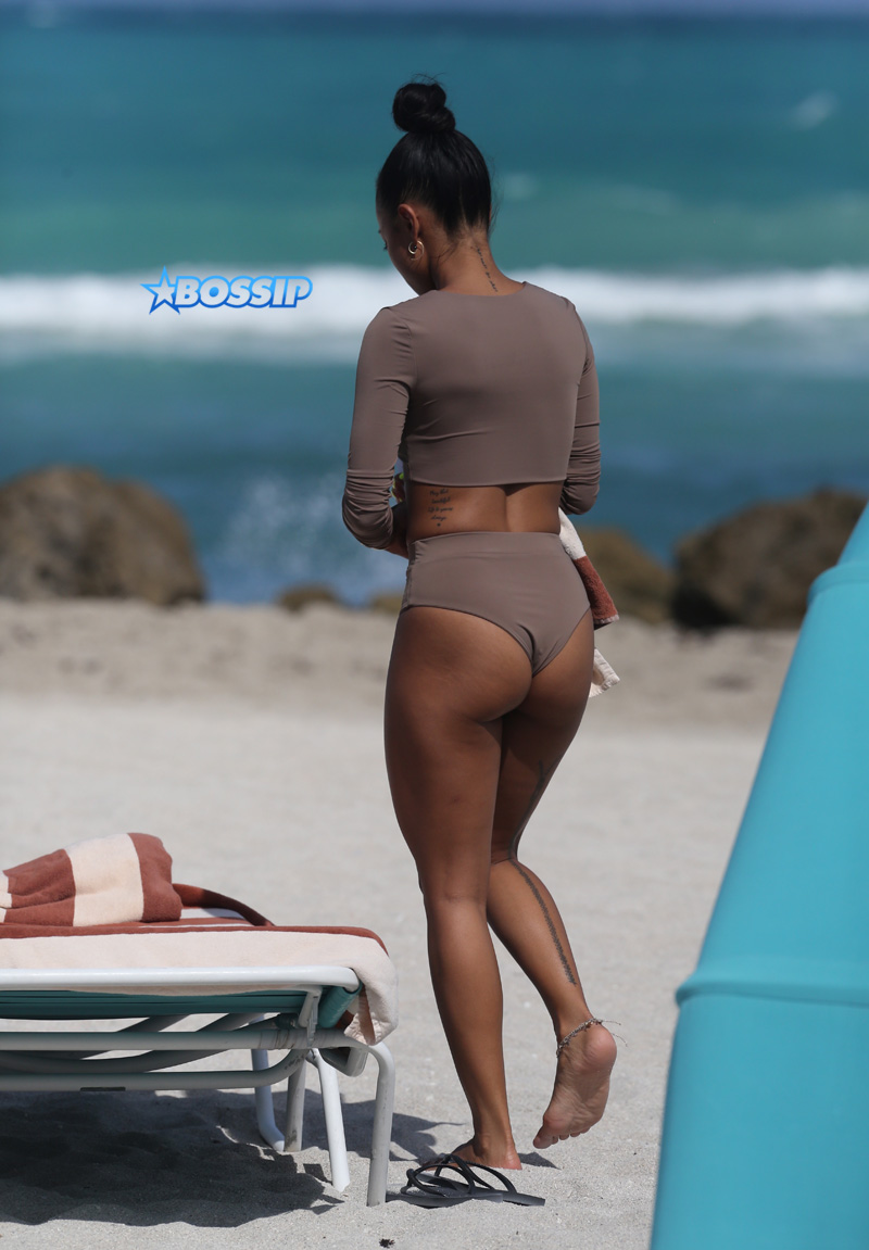"15 APRIL 2017 Karrueche Tran enjoys relaxing on the beach with her friends in a tan bikini. The actress leafs through a script titled ""Claws"" and seems to be a TV script as it also indicates it has episodes. The script is directed by 'Mozart in the Jungle' director Tricia Brock and written by Leila Gerstein who has written scripts for 'Gossip Girl' 'The OC' and 'Hart of Dixie'. Pictured: Karrueche Tran OHPIX/SplashNews"