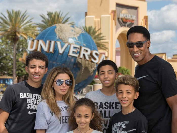 Publicity photo of Larsa Pippen, Scottie Pippen and kids by the Globe and Universal Arches