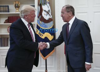 WASHINGTON, USA - MAY 10: US President Donald Trump (R) and Russia's Foreign Minister Sergei Lavrov (L) shake hands as they meet at the Oval Office of White House in Washington, D.C., United States on May 10, 2017. (Photo by Russia Foreign Minister Press Ofice /Anadolu Agency/Getty Images)