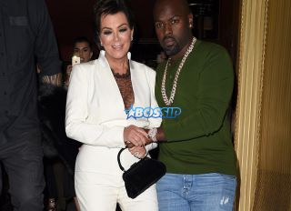 Kris Jenner looks worst for wear as she is helped to her waiting car by Corey Gamble after a 4 hour bender at the Costes Restuarnt in Paris.